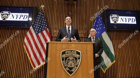 Stock Picture of Fbi Director James Comey (l) Speaks to Reporters After Addressing the Nypd Shield Security Conference As New York City Police Commissioner William J Bratton (r) Looks on at Police Headquarters in New York New York Usa 16 December 2015 Shield is an Umbrella Program For a Series of Police Initiatives Relating to Private Sector Security and Counterterrorism United States New York