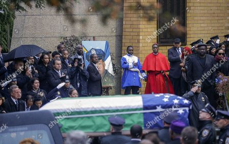 The Casket Containing the Body of New York Police Department Officer Randolph Holder is Loaded Into a Hearse From the Greater Allen a M E Cathedral and Conference Center During the Officer's Funeral in the Jamaica Neighborhood of Queens New York Usa 28 October 2015 Holder 33 a Native of Guyana was Shot and Killed While Chasing a Suspect in the East Harlem Area of Manhattan Holder Will Be Buried in Guyana United States Queens
