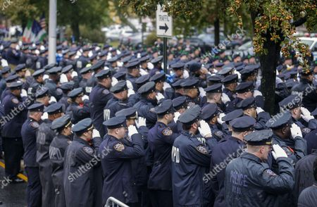 Stock Photo of Police Officers Salute While Paying Their Final Respects Outside the Greater Allen a M E Cathedral and Conference Center During the Funeral of New York Police Department Officer Randolph Holder in the Jamaica Neighborhood of Queens New York Usa 28 October 2015 Holder 33 a Native of Guyana was Shot and Killed While Chasing a Suspect in the East Harlem Area of Manhattan Holder Will Be Buried in Guyana United States Queens