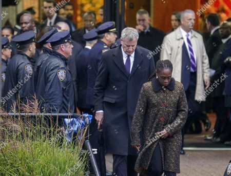 New York City Mayor Bill De Blasio (l) and His Wife Chirlane Mccray (r) Depart the Greater Allen a M E Cathedral and Conference Center After Attending the Funeral of New York Police Department Officer Randolph Holder in the Jamaica Neighborhood of Queens New York Usa 28 October 2015 Holder 33 a Native of Guyana was Shot and Killed While Chasing a Suspect in the East Harlem Area of Manhattan Holder Will Be Buried in Guyana United States Queens