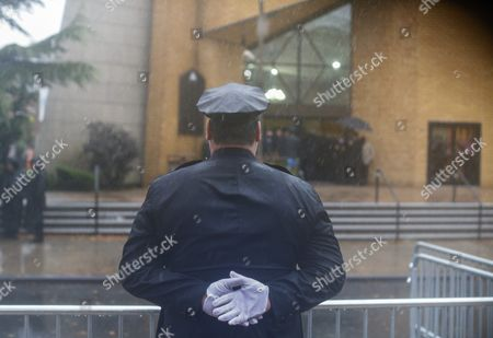 A Police Officer Pays His Respect Outside the Greater Allen a M E Cathedral and Conference Center During the Funeral of New York Police Department Officer Randolph Holder in the Jamaica Neighborhood of Queens New York Usa 28 October 2015 Holder 33 a Native of Guyana was Shot and Killed While Chasing a Suspect in the East Harlem Area of Manhattan United States Queens
