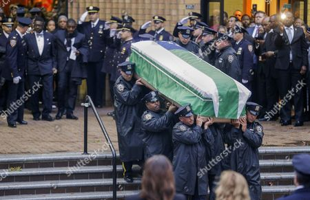 The Casket Containing the Body of New York Police Department Officer Randolph Holder is Carried From the Greater Allen a M E Cathedral and Conference Center During the Murdered Officer's Funeral in the Jamaica Neighborhood of Queens New York Usa 28 October 2015 Holder 33 a Native of Guyana was Shot and Killed While Chasing a Suspect in the East Harlem Area of Manhattan Holder Will Be Buried in Guyana United States Queens