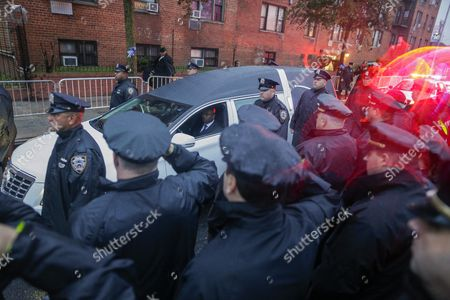 Police Officers Salute As the Hearse Passes Outside the Greater Allen a M E Cathedral and Conference Center During the Funeral of New York Police Department Officer Randolph Holder in the Jamaica Neighborhood of Queens New York Usa 28 October 2015 Holder 33 a Native of Guyana was Shot and Killed While Chasing a Suspect in the East Harlem Area of Manhattan Holder Will Be Buried in Guyana United States Queens