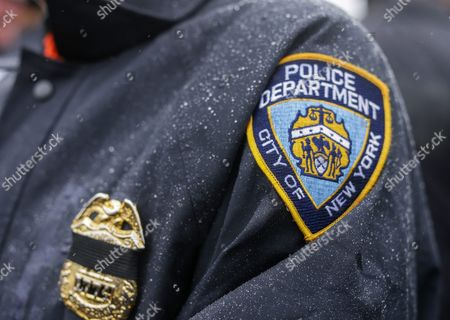A Police Officer Waits in the Rain Outside the Greater Allen a M E Cathedral and Conference Center For the Funeral of New York Police Department Officer Randolph Holder in the Jamaica Neighborhood of Queens New York Usa 28 October 2015 Holder 33 a Native of Guyana was Shot and Killed While Chasing a Suspect in the East Harlem Area of Manhattan United States Queens