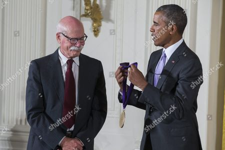 Stock Photo of Us President Barack Obama (r) Presents a 2014 National Medal of Arts to Tobias Wolff (l) For His Contributions As an Author and Educator in the East Room of the White House in Washington Dc Usa 10 September 2015 Obama Awarded 21 Arts and Humanities Medals During the Event United States Washington