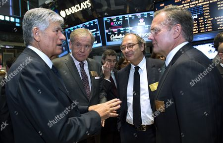 (l-r) Maurice Levy the Ceo of Publicis John Wren Ceo of Omnicom Jean-michel Etienne the Cfo of Publicis and Randall Weisenburger the Cfo of Omnicom Talk Together During an Appearance at the New York Stock Exchange to Celebrate the Announcement of the Planned Merger of Their Two Companies in New York New York Usa 29 July 2013 the Advertising Firms Announced Plans Over the Weekend to Merge Which Would Create the World's Biggest Advertising Group Worth an Estimated 35 1billion Us Dollars United States New York
