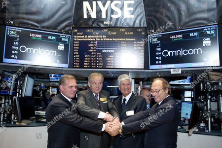 John Wren (2-l) Ceo of Omnicom and Maurice Levy ( 2-r) the Ceo of Publicis Stand with Jean-michel Etienne (r) the Cfo of Publicis and Randall Weisenburger (l) the Cfo of Omnicom Together During an Appearance at the New York Stock Exchange to Celebrate the Announcement of the Planned Merger of Their Two Companies in New York New York Usa 29 July 2013 the Advertising Firms Announced Plans Over the Weekend to Merge Which Would Create the World's Biggest Advertising Group Worth an Estimated 35 1billion Us Dollars United States New York