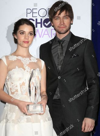 Australian Actress Adelaide Kane (l) and Canadian Actor Torrance Coombs (r) Pose in the Press Room the 40th People's Choice Awards Held at the Nokia Theater in Los Angeles California Usa 08 January 2014 United States Los Angeles