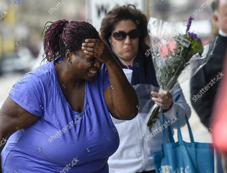 Rose Smith (l) of Missouri is Overcome with Emotion As She Talks About Prince Near a Makeshift Memorial For Prince at First Avenue the Nightclub where Prince Got His Start in Minneapolis Minnesota Usa 22 April 2016 Us Singer-songwriter and Musician Prince Died on 21 April at His Residence in Chanhassen Minnesota He was 57 United States Minneapolis