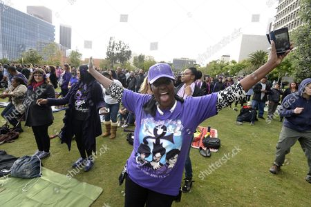 Linette Akinfolarin Wearing a Prince Shirt Dances in Grand Park where Thousands of Fans Gathered to Celebrate the Life of the Late Us Entertainment Legend Prince in Los Angeles California Usa 06 May 2016 Prince Whose Full Name was Prince Rogers Nelson Died at the Age of 57 at His Home in Paisley Park Minnesota on 21 April 2016 United States Los Angeles