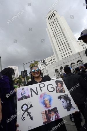 Ined Deltufo Holds Up a Poster with Pictures of Prince in Grand Park where Thousands of Fans Gathered to Celebrate the Life of the Late Us Entertainment Legend Prince in Los Angeles California Usa 06 May 2016 Prince Whose Full Name was Prince Rogers Nelson Died at the Age of 57 at His Home in Paisley Park Minnesota on 21 April 2016 United States Los Angeles