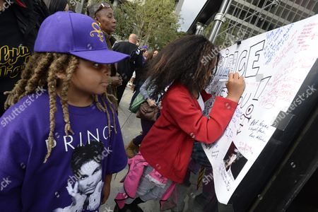 Keing Berry (l) Watches His Sister Sign a Memorial Board in Grand Park where Thousands of Fans Gathered to Celebrate the Life of the Late Us Entertainment Legend Prince in Los Angeles California Usa 06 May 2016 Prince Whose Full Name was Prince Rogers Nelson Died at the Age of 57 at His Home in Paisley Park Minnesota on 21 April 2016 United States Los Angeles