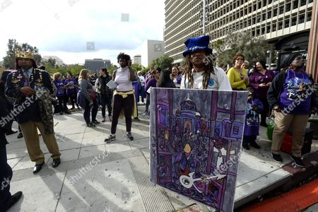 An Artist Germiles Holds a Painting of Prince in Grand Park where Thousands of Fans Gathered to Celebrate the Life of the Late Us Entertainment Legend Prince in Los Angeles California Usa 06 May 2016 Prince Whose Full Name was Prince Rogers Nelson Died at the Age of 57 at His Home in Paisley Park Minnesota on 21 April 2016 United States Los Angeles