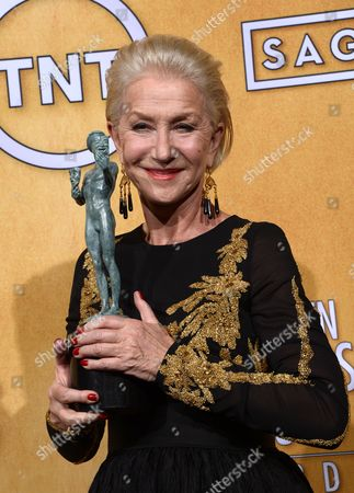 British Actress Helen Mirren Holds the Award For 'Outstanding Performance by a Female Actor in a Television Movie Or Miniseries' in 'Phil Spector' at the 20th Annual Screen Actors Guild Awards at the Shrine Auditorium in Los Angeles California Usa 18 January 2014 United States Los Angeles