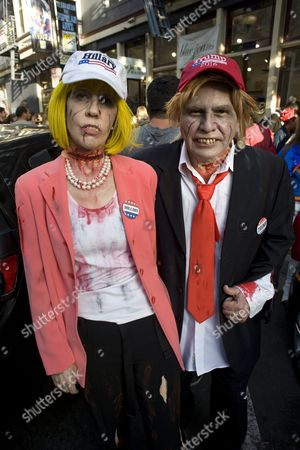 Stock Image of Donna and Dave Hester a Married Couple Dressed As Zombie Versions of Hillary Clinton and Donald Trump Pose For a Photo After a Zombie Walk Through Downtown San Diego on the Third Day of Comic Con 2016 in San Diego California Usa 23 July 2016 the San Diego Comic Con 2016 Runs From 21 Until 24 July United States San Diego
