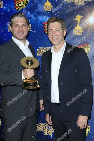 Us Producers/writers Aaron Helbing(l) Todd Helbing Pose with Their Award at the 42nd Annual Saturn Awards Held at the Castaway in Burbank California Usa 22 June 2016 the Saturn Awards Honors the Best in Science Fiction Fantasy Horror and Other Genres in Film Television Home Media Releases and Theatre United States Burbank