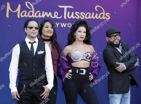 Stock Photo of Us Singer Chris Perez (l) Widower of the Late Us Singer Selena Quintanilla Sister Suzette Quintanilla (2-l) a Wax Figure Made in the Likeness of Late Us Singer Selena Quintanilla (2-r) and Us Musician a B Quintanilla (r) Brother of Selena Pose with the Wax Figure of Selena at Madame Tussaud's in Hollywood California Usa 30 August 2016 Selena Quintanilla was One of the Most Celebrted Mexican-american Entertainers of All Times and was Referred to As the 'Queen of Tejano Music' Selena was Murdered by a Woman She Employed in Her Boutique in 1995 United States Hollywood