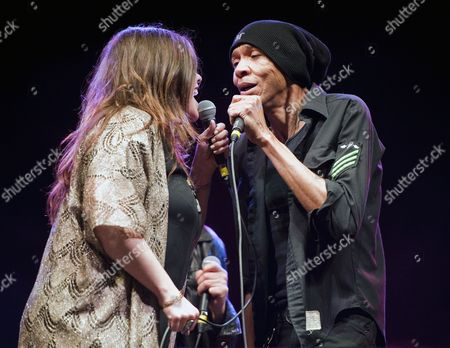 Us Singer Mary Bridget Davies (l) Lead Actress of a Night with Janis Joplin and Us Bass Player Dug Pinnick of King's X Perform on the Butler Park Outdoor Stage As Part of a Jimi Hendrix Musical Tribute to Celebrate the Release of the Us Postal Service's Jimi Hendrix Limited-edition Postal Stamp During the Music Portion of South by Southwest in Austin Texas Usa 13 March 2014 South by Southwest (sxsw) Conferences and Festivals Offer the Unique Convergence of Original Music Independent Films and Emerging Technologies United States Austin