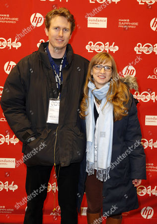Stock Photo of Producers Helen Estabrook (r) and Couper Samuelson (l) Arrive For the Premiere of 'Whiplash' During the 2014 Sundance Film Festival at the Eccles Theatre in Park City Utah Usa 16 January 2014 the Festival Runs From 16 to 26 January United States Park City