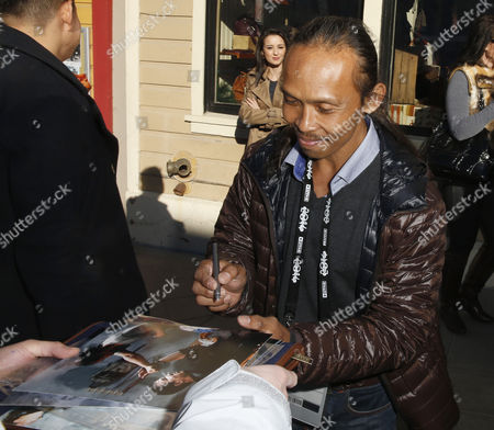 Indonesian Actor/cast Member Yayan Ruhian From the Film 'The Raid Two' Signs Autographs Along Old Main Street During the 2014 Sundance Film Festival in Park City Utah Usa 21 January 2014 the Festival Runs From 16 to 26 January United States Park City