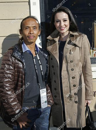 Indonesian Actors/cast Members Yayan Ruhian (l) and Julie Estelle (r) From the Film 'The Raid Two' Pose For Pictures at Old Main Street During the 2014 Sundance Film Festival in Park City Utah Usa 21 January 2014 the Festival Runs From 16 to 26 January United States Park City