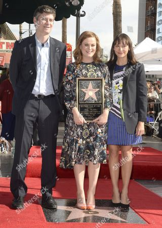 Us Actresses Amy Poehler (c) Rashida Jones (r) and Us Producer Mike Schur (l) Stand Next to Poehler's Star During a Ceremony Honoring Her on the Hollywood Walk of Fame in Hollywood California Usa 03 December 2015 Poehler who Stars in the Upcoming 'Sisters' Movie Received the 2 566th Star in the Television Category United States Hollywood