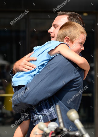 Tom Donahue Son of Michael Donahue Holds His Godson After Addressing Reporters Outside the John Joseph Moakley Federal Courthouse Following the Guilty Verdict For James 'Whitey' Bulger in His Racketeering Trial in Boston Massachusetts Usa 12 August 2013 Bulger was Also Found Guilty in the Murder of Michael Donahue United States Boston