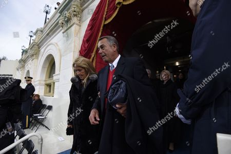 Former Speaker of the House John Boehner and his wife Debbie arrive for the Presidential Inauguration of Donald Trump at the US Capitol in Washington, DC,. / AFP PHOTO / POOL / SAUL LOEB