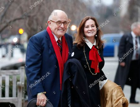 Rudy Giuliani and his wife Judith, arrives for a church service at St. John's Episcopal Church across from the White House in Washington, on Donald Trump's inauguration day