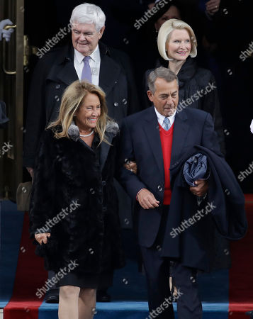 Former Speaker John Boehner, front right, of Ohio arrives with his wife Debbie followed by former House Speaker Newt Gingrich and his wife Callista before the 58th Presidential Inauguration at the U.S. Capitol in Washington