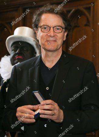 French Singer Francis Cabrel Poses After Receiving the Medal of Recognition From the City of Brussels at the City Town Hall in Brussels Belgium 14 April 2014 Francis Cabrel Has Been Recognized For His Charity Actions Belgium Brussels