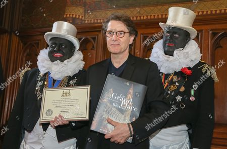 French Singer Francis Cabrel (c) Poses Flanked by Two'noirauds' Association's Members After Receiving the Medal of Recognition From the City of Brussels at the City Town Hall in Brussels Belgium 14 April 2014 Francis Cabrel Has Been Recognized For His Charity Actions Belgium Brussels