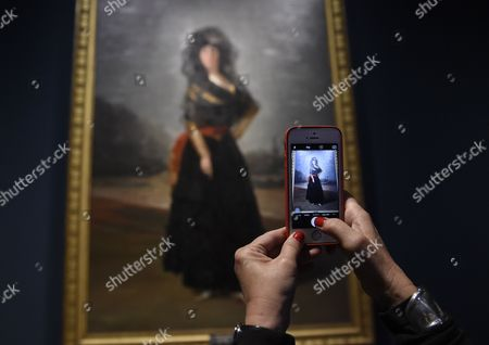 A Visitor Takes a Photograph with Her Mobile Phone of a Painting Entitled 'The Duchess of Alba' by Spanish Painter Francisco De Goya (1746-1828) During the Exhibition 'Goya the Portraits' at the National Gallery in London Britain 06 October 2015 the Exhibition Opens to the Public From 07 October to 10 January 2016 United Kingdom London