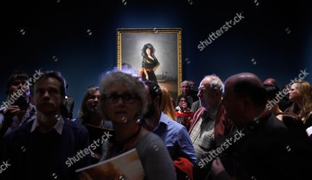 Visitors Stand in Front of a Painting Entitled 'The Duchess of Alba' by Spanish Painter Francisco De Goya (1746-1828) During a Preview of the Exhibition 'Goya the Portraits' at the National Gallery in London Britain 06 October 2015 the Exhibition Opens to the Public From 07 October to 10 January 2016 United Kingdom London