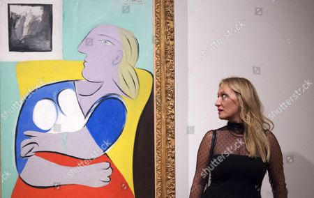 Diana Widmaier Picasso Granddaugther of Spanish Painter and Sculptor Pablo Picasso Poses Next to a Painting of Her Grandmother Marie-therese Walter Called 'Woman in the Yellow Armchair' During a Press Preview of 'Picasso Portraits' Exhibition at the National Portrait Gallery Central London Britain 05 October 2016 the Exhibition That Features Over 80 Portraits and Sculptures by the Famous Artist Runs From 06 October Until 05 February 2017 United Kingdom London