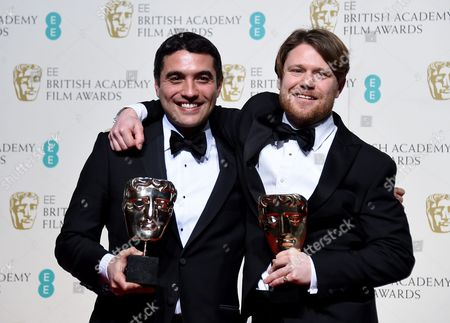 Naji Abu Nowar (l) and Rupert Lloyd (r) Pose in the Press Room After Winning the Outstanding Debut Award For 'Theeb' During the 69th Annual British Academy Film Awards at the Royal Opera House in London Britain 14 February 2016 the Ceremony is Hosted by the British Academy of Film and Television Arts (bafta) United Kingdom London