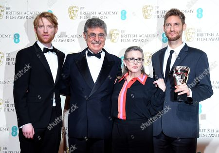 Stock Photo of Hugo Sigmam (2-l) and Damian Szifron (r) Pose in the Press Room with Domhnall Gleeson (l) and Carrie Fisher (2-r) After Winning the Film not in the English Language Award For 'Wild Tales' During the 69th Annual British Academy Film Awards at the Royal Opera House in London Britain 14 February 2016 the Ceremony is Hosted by the British Academy of Film and Television Arts (bafta) United Kingdom London