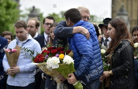 British Labour Party Politician Mp John Cryer Mp (c-l) Hugs British Labour Party General Secretary Iain Mcnicol (c-r) Before Laying Flowers in Memory of British Mp Jo Cox in Parliament Square London Britain 17 June 2016 Labour Mp Jo Cox was Reported Dead at the Hospital in Leeds After Being Shot and Critically Injured in Birstall on 16 June Cox was Airlfted From the Attack Scene to a Hospital in Leeds where She Later Died Cox Had in Recent Weeks Campaigned For the Remain Camp Britons Will Vote on Whether Or not They Want Remain in the Eu on 23 June Epa/hannah Mckay United Kingdom London