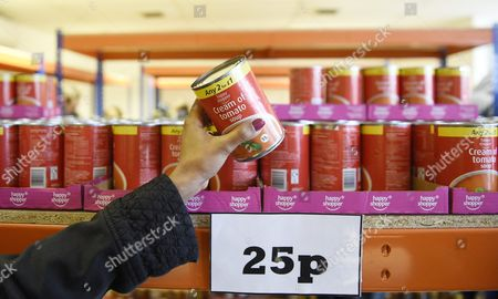 A Customer Picks a Tin of Tomato Soup in New Easyfoodstore Budget Supermarket in Park Royal North London Britain 03 February 2016 the Discount Shop Which is Owned by the Easyjet Owner Stelios Haji-ioannou is Selling a Range of Food Products All at 25pence Each Ranging From Pasta to Beans to Cleaning Products Fresh Meat Fruit and Vegetables Are not Yet Available United Kingdom London