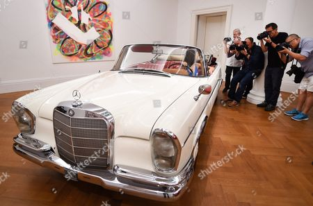 British Actor James Mason's Mercedes-benz 300se Cabriolet - and a Model Sitting at Its Wheel - is in the Focus of Photographers at Sotheby's Auction House in London Britain 12 August 2016 Mason's Car Which was Used During His Time on Holidays in Switzerland is Expected to Fetch Between 200 000 and 300 000 Euros at Auction in London on 07 September 2016 United Kingdom London