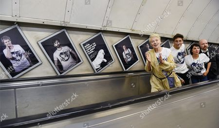 British Fashion Designer Vivienne Westwood (l) Rides an Escalator with Model Leebo Freeman (2-l) Actress Sadie Frost (2-r) and Photographer Andy Gotts (r) During the Launch of 'Save the Arctic' Photographic Exhibition at Waterloo Station in London Britain 13 July 2015 the Exhibition of Photographs of Celebrities Wearing Save the Arctic T-shirts Reflects a Global Call For the Protection of the Arctic United Kingdom London