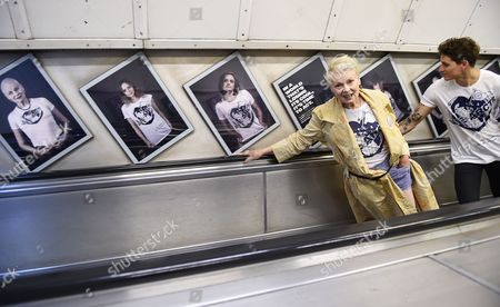 British Fashion Designer Vivienne Westwood (l) Rides an Escalator with Model Leebo Freeman (r) During the Launch of 'Save the Arctic' Photographic Exhibition at Waterloo Station in London Britain 13 July 2015 the Exhibition of Photographs of Celebrities Wearing Save the Arctic T-shirts Reflects a Global Call For the Protection of the Arctic United Kingdom London
