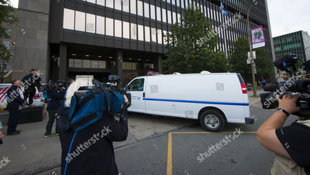 Reporters Film a Prison Van Carrying Defendant Luka Magnotta Arriving at Court in Montreal Canada 29 September 2014 on the First Day of Magnotta's Murder Trial Magnotta is Accused of Murdering Chinese Student Jun Lin in 2012 Magnotta Pleaded not Guilty to Five Charges Canada Montreal