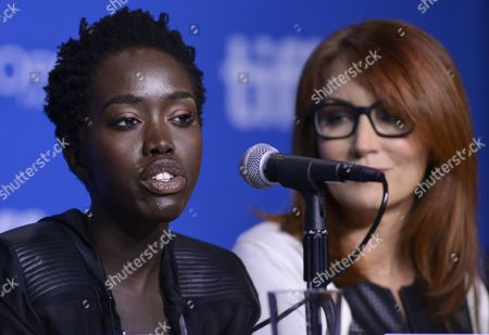 South Sudanese Actress and Cast Member Kuoth Wiel (l) Speaks at the Press Conference For 'The Good Lie' As Us Writer Margaret Nagle (r) Looks on During the 39th Annual Toronto International Film Festival (tiff) in Toronto Canada 08 September 2014 the Festival Runs From 04 to 14 September Canada Toronto