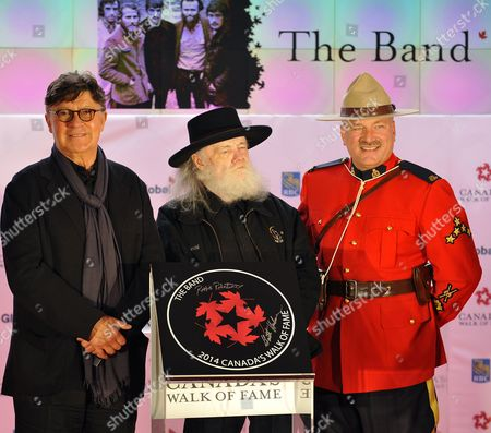Stock Picture of Canadian Rock Musicians Robbie Robertson (l) and Garth Hudson (c) Surviving Members of the Band Are Inducted Into Canada's Walk of Fame in Toronto Canada 18 October 2014 the 17th Annual Walk of Fame Celebrates Canadians who Have Achieved Excellence in Music Film Television Literature Visual and Performing Arts Sports Science and Innovation Canada Toronto