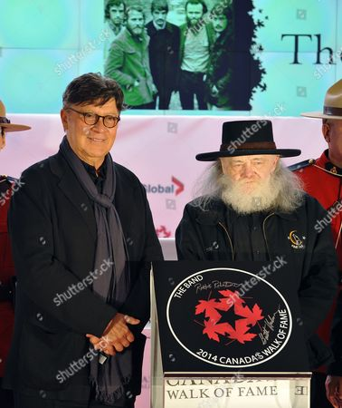 Stock Image of Canadian Rock Musicians Robbie Robertson (l) and Garth Hudson Surviving Members of the Band Are Inducted Into Canada's Walk of Fame in Toronto Canada 18 October 2014 the 17th Annual Walk of Fame Celebrates Canadians who Have Achieved Excellence in Music Film Television Literature Visual and Performing Arts Sports Science and Innovation Canada Toronto
