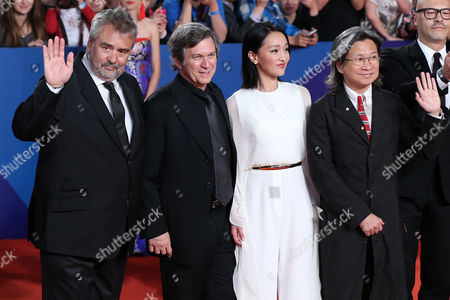 (l-r) the Jury of the Tiantan Awards French Filmmaker Luc Besson Us Writer Robert Kamen Chinese Actress Zhou Xun and Hong Kong Director Peter Chan Pose For Photographers As They Arrive on the Red Carpet For the Closing Ceremony of the 5th Beijing International Film Festival in Beijing China 23 April 2015 the Event was Held From 16 to 23 April China Beijing