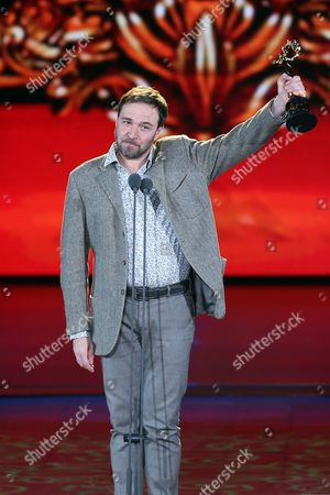Russian Actor Artem Tsypin Receives the 'Best Actor Award' During the Closing Award Ceremony of the 5th Beijing International Film Festival in Beijing China 23 April 2015 the Event was Held From 16 to 23 April China Beijing