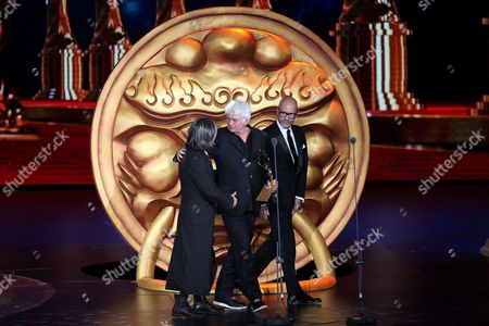 French Filmmaker Jean-jacques Annaud (c) Holds His 'Best Director Award' Onstage Next to Hong Kong Director Peter Chan (l) and Russian Director Fyodor Bondarchuk (r) During the Closing Award Ceremony of the 5th Beijing International Film Festival in Beijing China 23 April 2015 the Event was Held From 16 to 23 April China Beijing