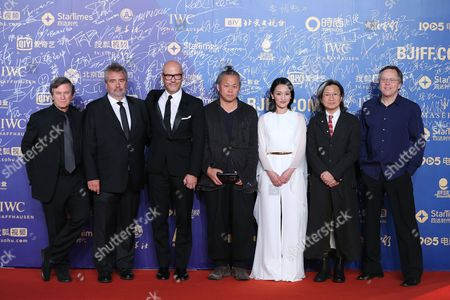(l-r) the Jury of the Tiantan Awards Us Writer Robert Kamen French Filmmaker Luc Besson Russian Director Fyodor Bondarchuk South Korean Director Kim Ki-duk Chinese Actress Zhou Xun Hong Kong Director Peter Chan and Brazilian Director Fernando Meirelles Pose For Photographers As They Arrive on the Red Carpet For the Closing Ceremony of the 5th Beijing International Film Festival in Beijing China 23 April 2015 the Event was Held From 16 to 23 April China Beijing